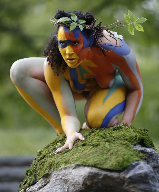 "Reanna Roane, as ""Ariel"", perches on a rock in Central Park during the Outdoor Co-Ed Topless Pulp Fiction Appreciation Society theater company's performance of Shakespeare's ""The Tempest"", Thursday, May 19, 2016, in New York. (Photo by Kathy Willens/AP Photo)"