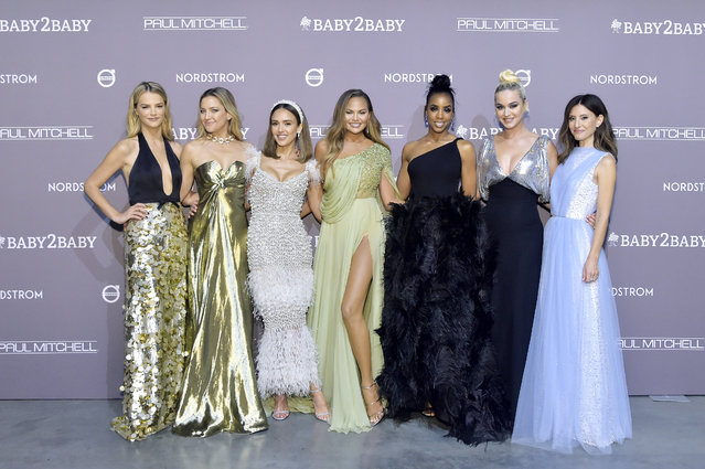 (L-R) Baby2Baby Co-president Kelly Sawyer Patricof, Kate Hudson, Jessica Alba, Chrissy Teigen, Kelly Rowland, Katy Perry and Baby2Baby Co-president Norah Weinstein attend the 2019 Baby2Baby Gala presented by Paul Mitchell on November 09, 2019 in Los Angeles, California. (Photo by Stefanie Keenan/Getty Images for Baby2Baby)