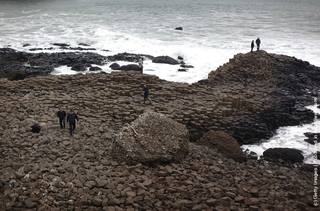 Visitors walk on the Giant's Causway in Portrush, Northern Ireland