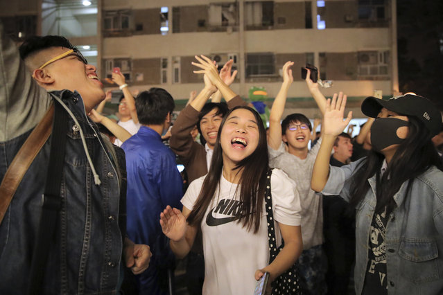 Pro-democracy supporters celebrate after pro-Beijing politician Junius Ho lost his election in Hong Kong, early Monday, November 25, 2019. Vote counting was underway in Hong Kong early Monday after a massive turnout in district council elections seen as a barometer of public support for pro-democracy protests that have rocked the semi-autonomous Chinese territory for more than five months. (Photo by Kin Cheung/AP Photo)