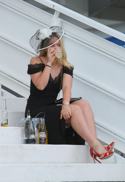 Race goers are pictured during the Investec Ladies Day at Epsom Downs Racecourse on June 2, 2017 in Epsom, England. (Photo by WENN)