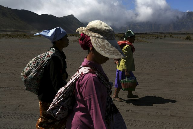 Hindu women villagers walks to the temple ahead of the annual Kasada festival at Mount Bromo in Indonesia's East Java province, July 31, 2015. (Photo by Reuters/Beawiharta)