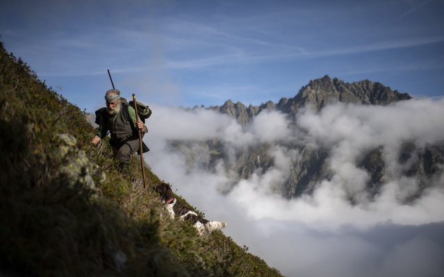 Hunter Peter Marugg and dog Fjura are on the hunt for chamois, pictured in the second of the three week long hunting season, 20 September 2019 in Klosters, Switzerland. 69 year old Peter Marugg hunts since 1970. Hunting has a long standing tradition in the canton of Graubuenden. Approximately 5500 hunters participate. (Photo by Gian Ehrenzeller/EPA/EFE/Rex Features/Shutterstock)