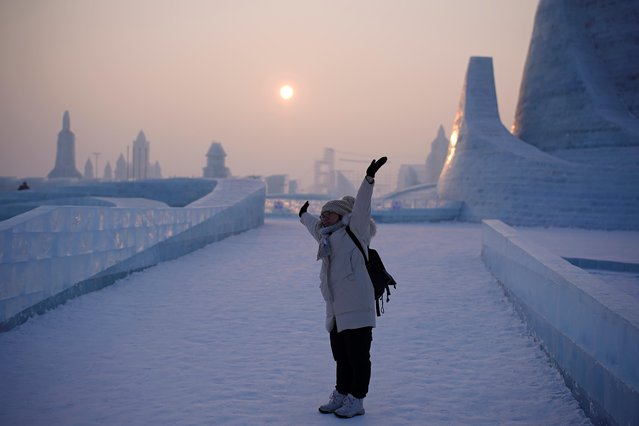 A woman visits ice sculptures ahead of the annual Harbin International Ice and Snow Sculpture Festival, in Harbin, Heilongjiang province, China on January 4, 2020. (Photo by Aly Song/Reuters)