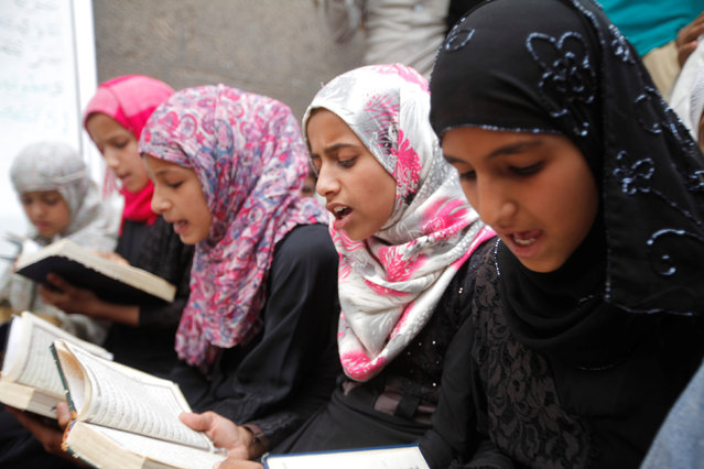 Girls read verses of the Koran at the Grand Mosque during the Muslim holy fasting month of Ramadan in Sanaa, Yemen June 24, 2016. (Photo by Mohamed al-Sayaghi/Reuters)