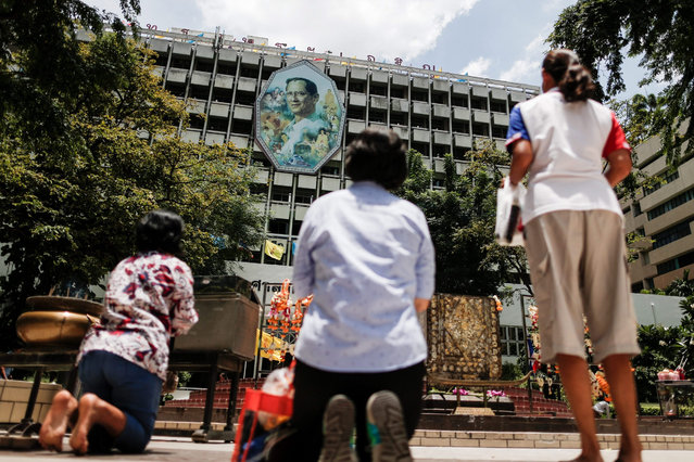 Thai people pray for the health of King Bhumibol Adulyadej and his Queen Sirikit outside the Siriraj hospital in Bangkok, Thailand, 14 August 2015. The world's longest living monarch, 87 year old Thai King Bhumibol Adulyadej and his Queen Sirikit, are recovering in the Siriraj hospital. According to palace statements on 10 August, revered King Bhumibol Adulyadej has been treated for water in the brain and a chest infection. (Photo by Diego Azubel/EPA)