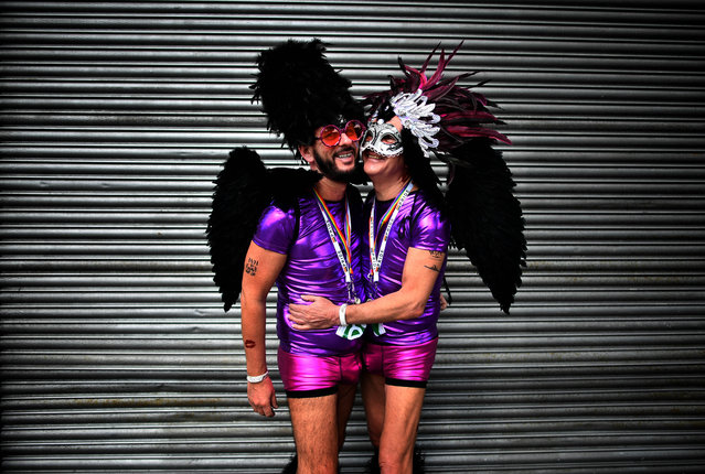 A gay couple embrace as they watch the Belfast Gay Pride march taking place on August 5, 2017 in Belfast, Northern Ireland. The province is the only part of the United Kingdom which does not recognise same s*x marriage. The Irish Republic's first gay prime minister Taoiseach Leo Varadkar today predicted it is only a matter of time before same s*x marriage is legalised in the north. Mr Varadkar was speaking at a Pride breakfast event. (Photo by Charles McQuillan/Getty Images)