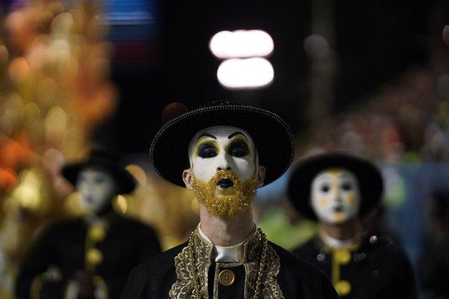 A performer from the Sao Clemente samba school parades during Carnival celebrations at the Sambadrome in Rio de Janeiro, Brazil, Monday, February 24, 2020. (Photo by Leo Correa/AP Photo)