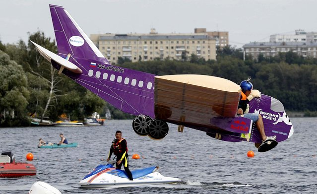 A makeshift aircraft plummets into the Moskva River during the Red Bull Flugtag Moscow 2011 competition. (Photo by Sergei Karpukhin/Reuters)