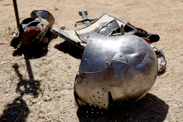 A helmet, shield and sword are seen during the International Medieval Combat at the castle of Belmonte, May 4, 2014, in Belmonte, Spain. This year was the first time women, who also dressed in full suits of armor, were allowed to compete. (Photo by Juan Naharro Gimenez/Getty Images)