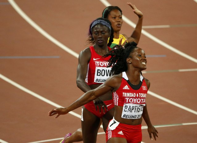 Kelly-Ann Baptiste of Trinidad And Tobago (bottom), Tori Bowie of U.S. (middle) and Natasha Morrison of Jamaica (top) react after the women's 100 metres semi-final during the 15th IAAF World Championships at the National Stadium in Beijing, China August 24, 2015. (Photo by David Gray/Reuters)