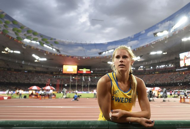 Michaela Meijer of Sweden speaks to her coach ahead of the women's pole vault final during the 15th IAAF World Championships at the National Stadium in Beijing, China, August 26, 2015. (Photo by Dylan Martinez/Reuters)