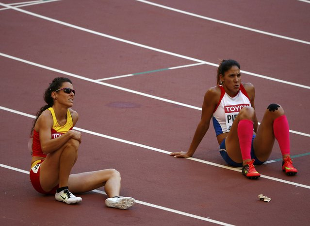 Tiffany Porter of Britain (R) and Caridad Jerez of Spain after competing in the women's 100 metres hurdles heats during the 15th IAAF World Championships at the National Stadium in Beijing, China August 27, 2015. (Photo by David Gray/Reuters)