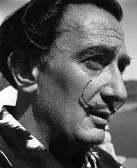 Surrealist artist Salvador Dali (1904–1989), with his distinctive moustache to the fore. 17th November 1951.  (Photo by Daniel Farson)