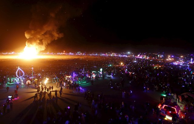"""Thousands watch as the Man is burned during the Burning Man 2015 """"Carnival of Mirrors"""" arts and music festival in the Black Rock Desert of Nevada September 5, 2015. (Photo by Jim Urquhart/Reuters)"""