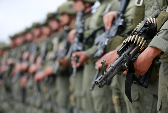 Colombian anti-narcotics police officers stand in formation before the embarking on anti-narcotics operations in San Jose del Guaviare, Colombia, August 2, 2016. Colombian law enforcement has destroyed 104 cocaine laboratories capable of producing some 100 tonnes of the drug annually, the head of the anti-narcotics police said on Tuesday. The operation, conducted over five days in the country's southeastern jungle region, is part of new government strategy focused on combating drug production as well as the cultivation of coca, the base ingredient of cocaine. The laboratories were burned down by police commandos. (Photo by John Vizcaino/Reuters)