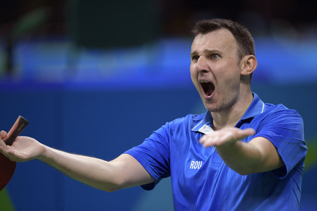Romania's Adrian Crisan reacts after winning his men's singles qualification round table tennis match against France's Emmanuel Lebesson at the Riocentro venue during the Rio 2016 Olympic Games in Rio de Janeiro on August 7, 2016. (Photo by Juan Mabromata/AFP Photo)