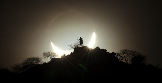 """Hybrid Solar Eclipse 2"". A Kenyan landscape serves as the foreground for a solar eclipse. Winner in the People and Space category. (Photo by Eugen Kamenew, Germany/The Astronomy Photographer of the Year 2014 Contest)"