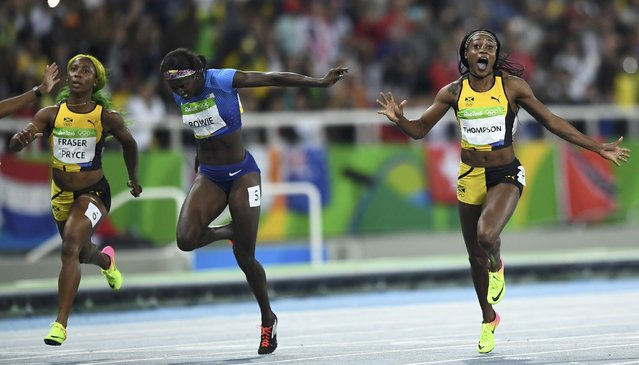 2016 Rio Olympics, Athletics, Final, Women's 100m Final, Olympic Stadium, Rio de Janeiro, Brazil on August 13, 2016. Elaine Thompson (JAM) of Jamaica celebrates as she wins the race ahead of Tori Bowie (USA) of USA and Shelly-Ann Fraser-Pryce (JAM) of Jamaica. (Photo by Dylan Martinez/Reuters)