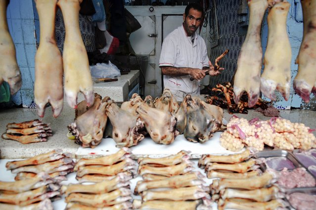 A butcher sells animal's legs and heads in Medina, Rabat's old city September 21, 2014. (Photo by Damir Sagolj/Reuters)