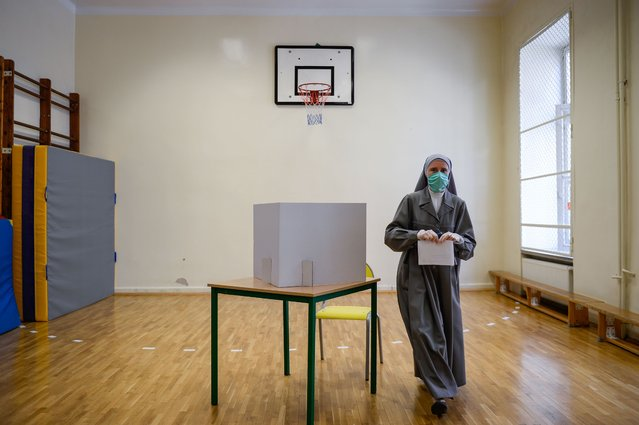 A nun wears a protective face mask as she casts her ballot during Poland's Presidential elections on June 28, 2020 in Krakow, Poland.The latest polling suggests current President Andrzej Duda may not claim enough votes to win in the first round and could face a run-off election against Warsaw mayor and presidential candidate of the center-right main opposition party, Civic Platform (PO), Rafal Trzaskowski. Todays election was originally scheduled for May but was postponed due to the coronavirus pandemic. (Photo by Omar Marques/Getty Images)