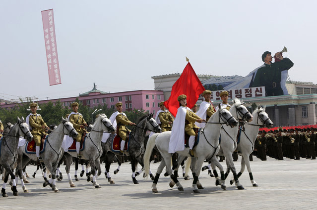 North Korean soldiers riding military horses parade to mark the 60th anniversary of the signing of a truce in the 1950-1953 Korean War at Kim Il-sung Square, in Pyongyang, July 27, 2013. (Photo by Jason Lee/Reuters)