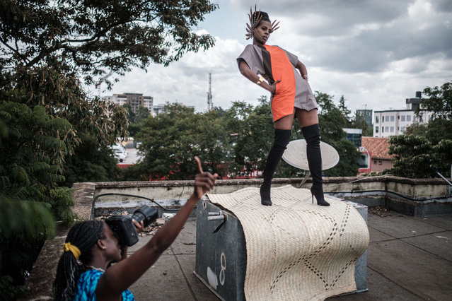 "Kenyan photographer and art director Barbara Minishi (L) takes pictures of her room mate and fashion stylist Wambui Thimba (R) wearing a creation by a Kenyan fashion designer on the rooftop of their apartment in Nairobi, Kenya, on June 1, 2020. After their scheduled works was cancelled due to the spread of the COVID-19 coronavirus, Minishi and Thimba have started their own project called ""the Kenya Fashion & Style Diary in 21 days"" to showcase a Kenyan fashion brand everyday for 3 weeks on social networking services since May 22, 2020 by only shooting at their apartment. (Photo by Yasuyoshi Chiba/AFP Photo)"