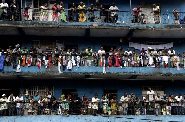 Residents of the Kissy neighborhood pack their balconies as they wait to see opposition candidate Julius Maada Bio, as his campaign convoy passes en route to his final rally in Freetown, Sierra Leone, November 15, 2012. Ten years after the end of a devastating civil war, Sierra Leone will go to the polls on Saturday to choose between candidates including Bio and incumbent President Ernest Bai Koroma. (Photo by Rebecca Blackwell/Associated Press)