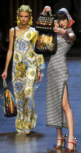 A model takes selfie with mobile phone as she presents a creation from the Dolce & Gabbana Spring/Summer 2016 collection during Milan Fashion Week in Italy, September 27, 2015. (Photo by Stefano Rellandini/Reuters)