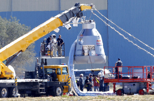 In this October 9, 2012, file photo, Felix Baumgartner, in pressurized suit on platform at left, prepares to enter the balloon capsule in Roswell, N.M. The Austrian daredevil became the first skydiver to break the speed of sound when he jumped from a small capsule 24 miles above the Earth on Oct. 14, 2012, and landed safely on the ground near Roswell, N.M., nine minutes later. Aikins helped train Baumgartner for that stunt and was the backup jumper. (Photo by Matt York/AP Photo)