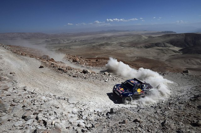 Qatar's Nasser Al-Attiyah and co-pilot Spain's Lucas Cruz compete with their Buggy during the 4th stage of the Dakar Rally 2013 from Nazca to Arequipa, January 8, 2013. (Photo by Franck Fife/Reuters)