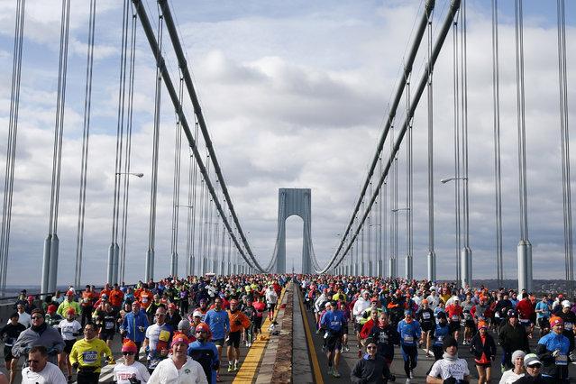 Runners cross the Verrazano-Narrows Bridge at the start of the New York City Marathon, Sunday, November 2, 2014, in New York. (Photo by Jason DeCrow/AP Photo)
