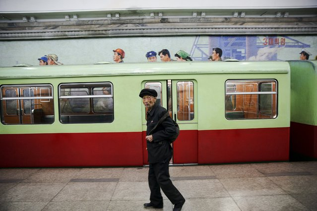 An elderly man arrives at a subway station visited by foreign reporters during a government organised tour in Pyongyang, North Korea October 9, 2015. One of the world's most inaccessible places, North Korea has invited foreign journalists to Pyongyang this week for celebrations marking the 70th anniversary of its ruling Workers' Party scheduled for October 10. (Photo by Damir Sagolj/Reuters)