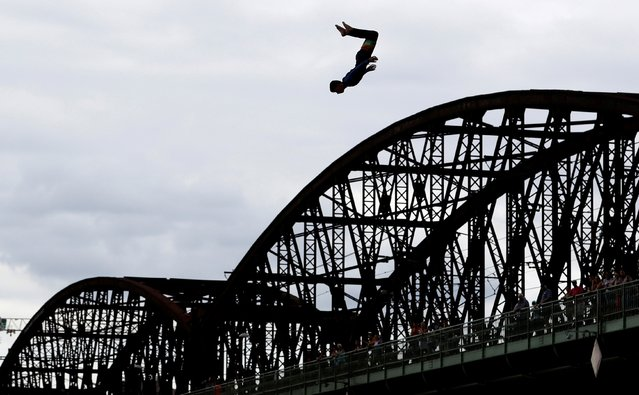A participant jumps into the Vltava river during a high diving competition in Prague, Czech Republic, August 22, 2020. (Photo by David W. Cerny/Reuters)