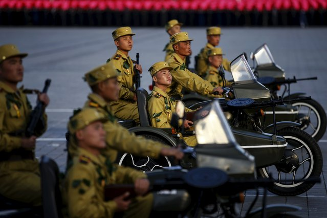 Soldiers ride motorcycles past a stand with North Korean leader Kim Jong Un during the parade celebrating the 70th anniversary of the founding of the ruling Workers' Party of Korea, in Pyongyang October 10, 2015. (Photo by Damir Sagolj/Reuters)