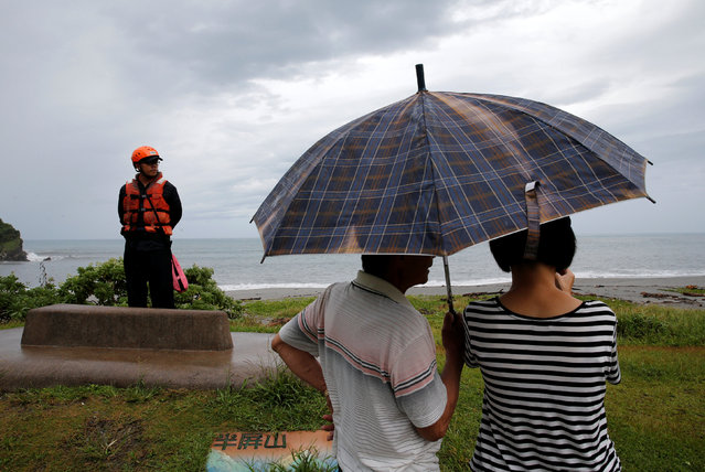 A coast guard stands guard at the coast as Typhoon Malakas approaches in Yilan, Taiwan September 17, 2016. (Photo by Tyrone Siu/Reuters)