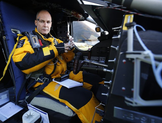 Swiss pilot Bertrand Piccard prepares for a test flight of the solar-powered Solar Impulse 2 experimental aircraft in Payerne November 13, 2014. (Photo by Ruben Sprich/Reuters)