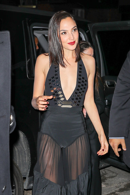 Gal Gadot is all excited while arriving at the Revlon event in New York City on January 24, 2018. Gal wore a plunging black gown with sheer skirt. (Photo by Felipe Ramales/Splash News and Pictures)