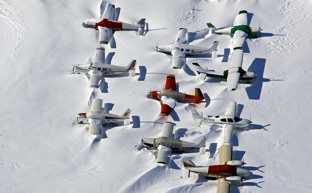 Small planes are snowed in at the closed Bridgeport, Connecticut airport in the aftermath of Nemo, the Blizzard of 2013. (Photo by Craig Ruttle/Associated Press)