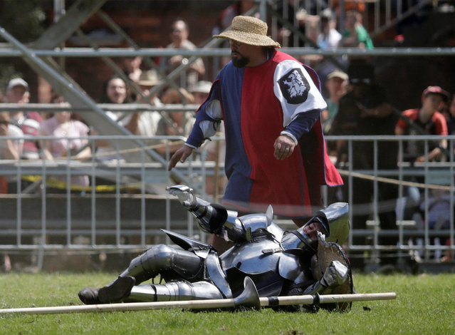 Australian jouster Cliff Marisma lays on the ground after falling off his horse during a jousting tournament at the St Ives Medieval Fair in Sydney, one of the largest of its kind in Australia, September 24, 2016. (Photo by Jason Reed/Reuters)