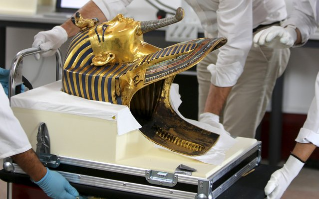 The golden mask of King Tutankhamun is pictured during its restoration process at the Egyptian Museum in Cairo, Egypt, October 20, 2015. (Photo by Mohamed Abd El Ghany/Reuters)