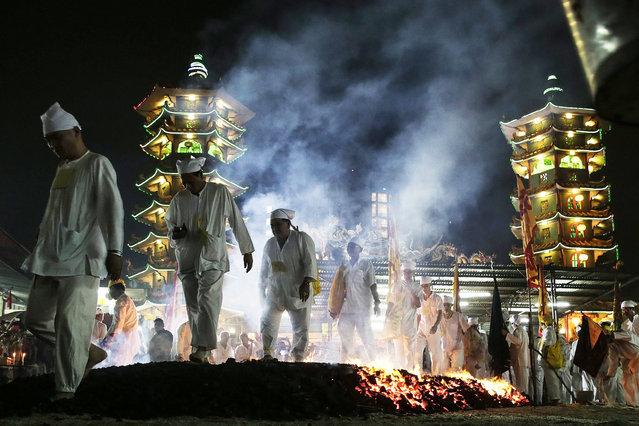 Malaysian ethnic Chinese walk on the burning charcoal on the last day of the Nine Emperor Gods festival in Kuala Lumpur, Malaysia, 21 October 2015. (Photo by Fazry Ismail/EPA)