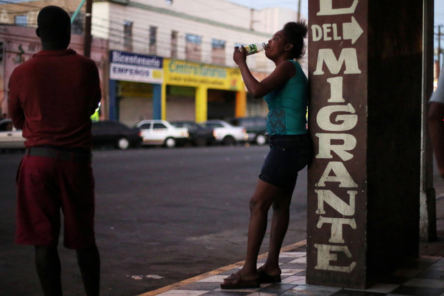 A Congolese migrant intending to seek asylum in the U.S. drinks outside a La Casa del Migrante shelter in Mexicali, Mexico, October 5, 2016. (Photo by Edgard Garrido/Reuters)