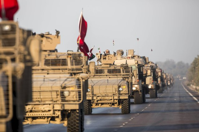 Members of the United Arab Emirates armed forces travel in military vehicles as the first batch of UAE military personnel returns from Yemen in Abu Dhabi, November 7, 2015. (Photo by Reuters/United Arab Emirates News Agency WAM)