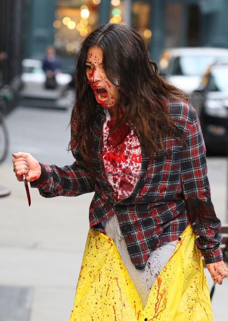 """Gina Rodriguez, covered in fake blood after stabbing someone in the neck, shows off her war face while filming a violent scene for her upcoming movie project """"Someone Great"""" in Manhattan's Soho Neighborhood, New York City on April 9, 2018. In between the horrific violence she was seen smooching with boyfriend Joe LoCicero and filming with her costars DeWanda Wise and Brittany Snow. (Photo by LGjr-RG/PacificCoastNews)"""