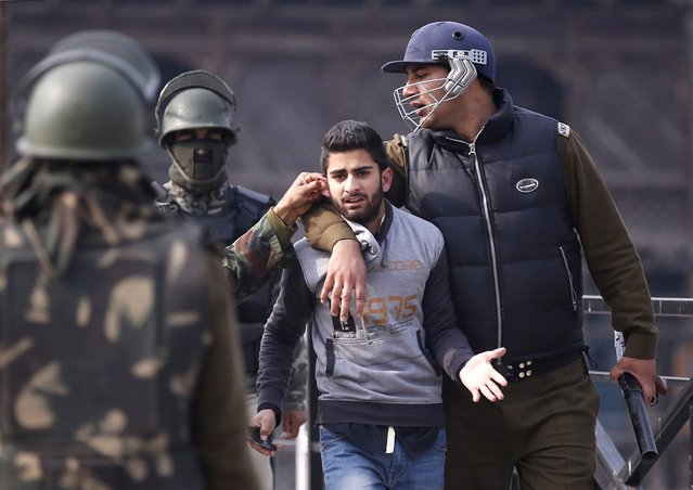 Indian policemen detain a Kashmiri demonstrator during a protest in Srinagar November 11, 2015. Indian authorities on Wednesday in parts of Srinagar city imposed restrictions by sealing off many residential areas to thwart a protest march called by separatists against the recent killing of a youth, local media reported. (Photo by Danish Ismail/Reuters)