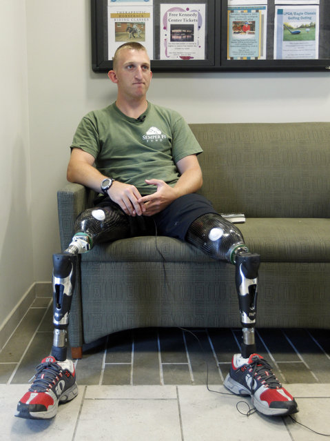 Marine Sgt. Rob Jones, 25, of Lovettsville, Va., listens to a question during an interview with The Associated Press at Walter Reed Army Medical Center in Washington, Thursday, July 21, 2011. Walter Reed Army Medical Center, the military's flagship hospital where privates to presidents have gone for care for more than a century, is closing its doors. (Photo by Luis M. Alvarez/AP Photo)