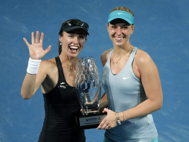 Martina Hingis (L) of Switzerland and Sabine Lisicki of Germany hold their trophy after winning the women's doubles final match at the Brisbane International tennis tournament in Brisbane, January 10, 2015. (Photo by Jason Reed/Reuters)