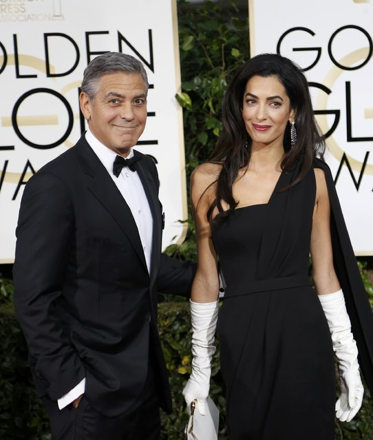 Actor George Clooney and his wife Amal Clooney arrive at the 72nd Golden Globe Awards in Beverly Hills, California January 11, 2015. (Photo by Mario Anzuoni/Reuters)