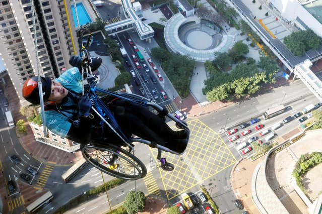 Lai Chi-wai, a paraplegic climber, attempts to climb the 320-metre tall Nina Tower using only his upper body strength, in Hong Kong, China January 16, 2021. On this attempt, Lai completed 250-meters (75/f), as he faced strong winds. (Photo by Tyrone Siu/Reuters)